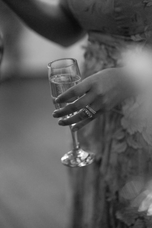 Detail of the Bride with a glass of Champagne