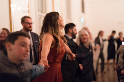 Wedding Guests dancing all together in a big never ending chain