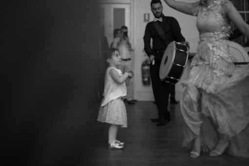 Bride dancing traditional Turkish dances while a little girl is next to her admiring her on the dancing floor