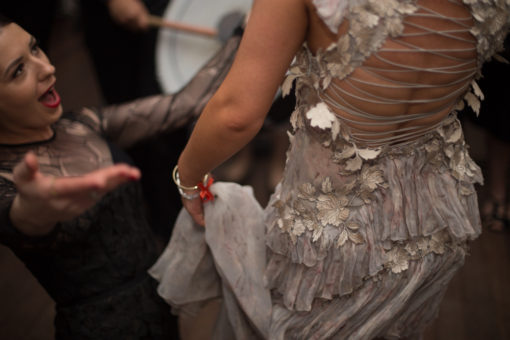 Detail of the Wedding Dress while the Bride is dancing