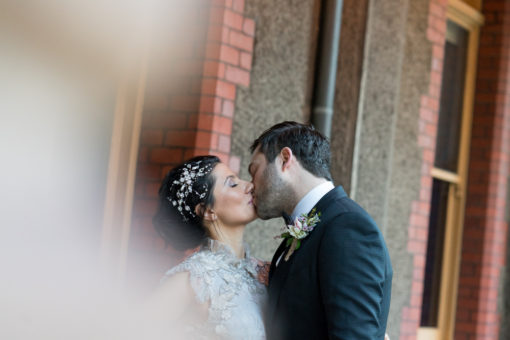 Bride and groom kissing at Abbotsford Convent