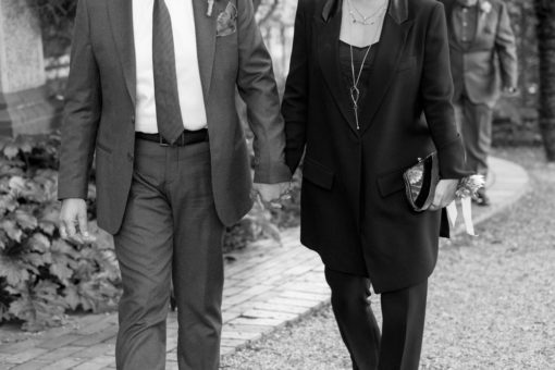Mum and Dad of the Groom holding hands