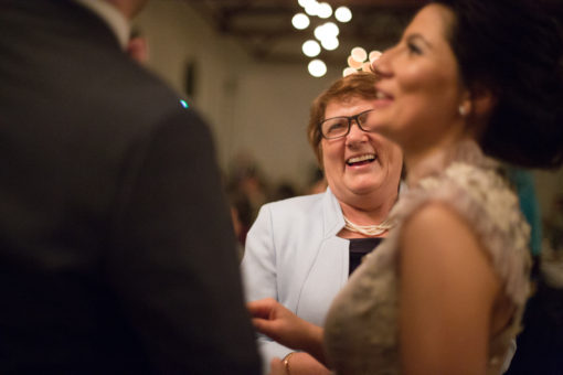 laughs with the Bride and her Mum