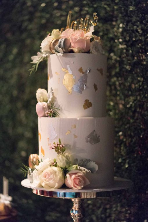 Engagement Party cake. White mud cake with gold and white and soft pink ornamental roses. Photo by Erika's Way Photography