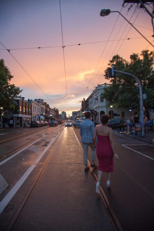 Candid shot of a couple in love walking together in the streets at sunset.