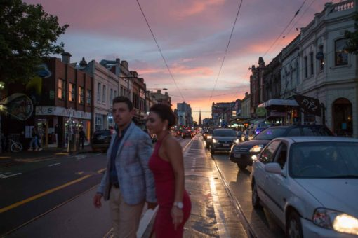 Bride and Groom walking in the streets at sunset. Candid shot, street Photography. Photo by Erika's Way Photography