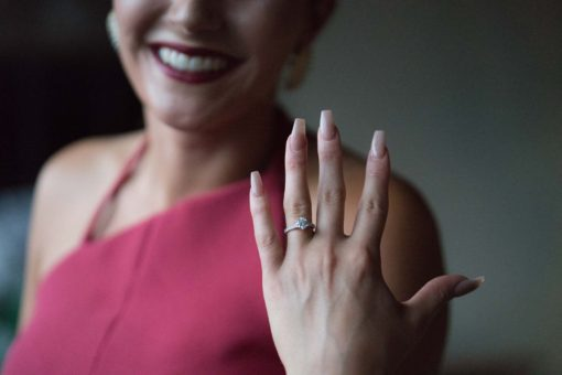 Showing off the engagement Ring. Photo by Erika's Way Photography
