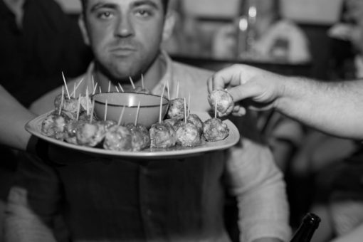 Detail of the finger food at the Engagement Party with funny face of one of the guests in the background. Photo by Erika's Way Photography