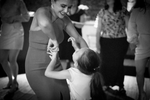 Bride dancing with a little one. Photo by Erika's Way Photography