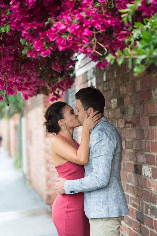 Passionate kiss under the most amazing Bougainvillea tree. Photo by Erika's Way Photography