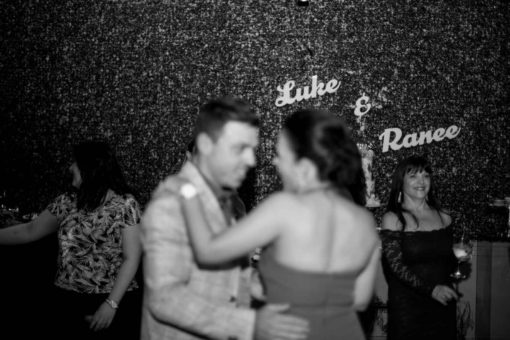 Bride and groom dancing out of focus on the dancing floor. Photo by Erika's Way Photography