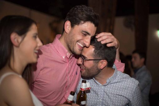 Cute and (a bit) drunk hug among friends at the Engagement Party. Photo by Erika's Way Photography