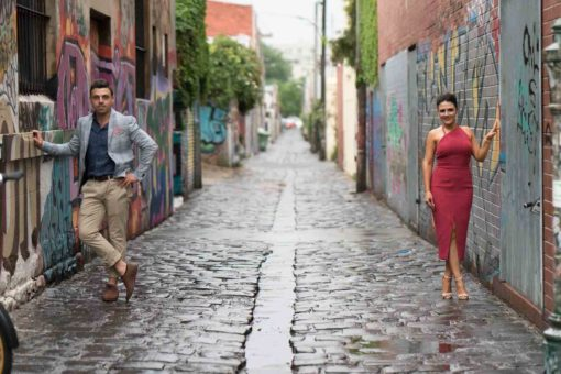 Bride and groom in an Alley. Photo by Erika's Way Photography