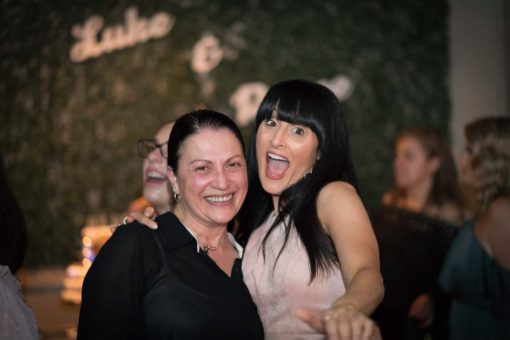 Having fun at the Engagement Party. Photo by Erika's Way Photography