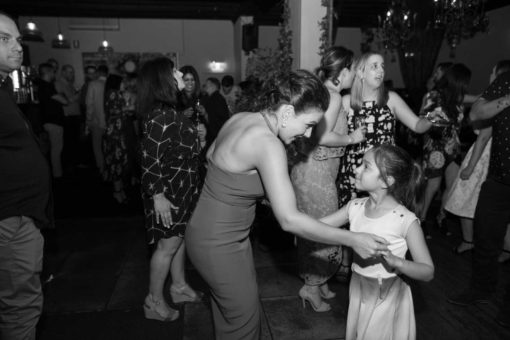 Bride dancing with her little cousins. Photo by Erika's Way Photography