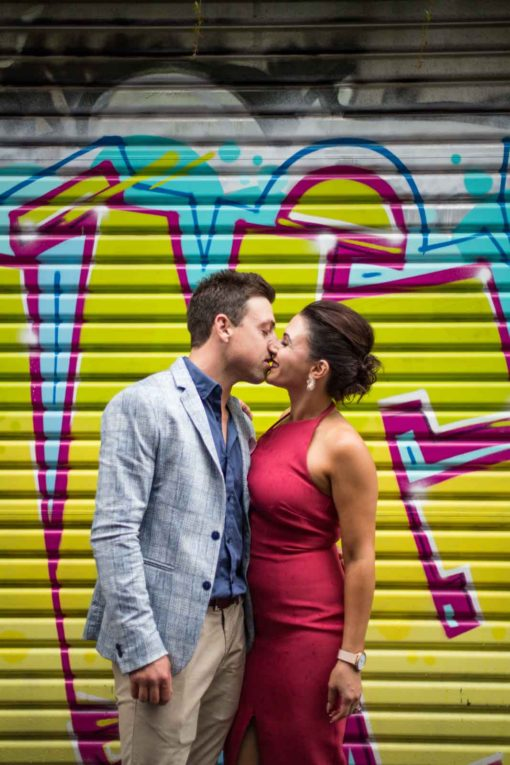 Kiss in front of a graffiti. Photo by Erika's Way Photography