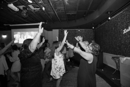 Dancing on the dance floor. Photo by Erika's Way Photography