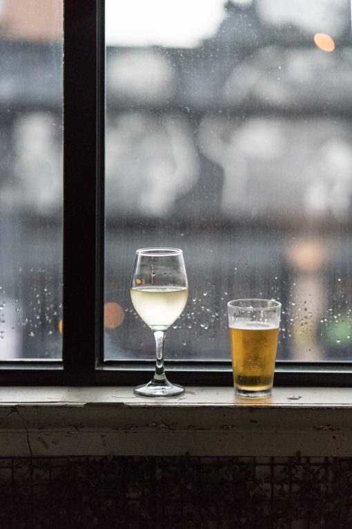 A beer for the Groom and a glass of sparkly white wine for the Bride. Photo by Erika's Way Photography